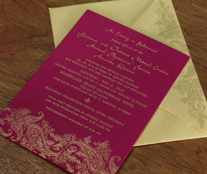 Gold foil stamped floral paisley wedding invitation with a