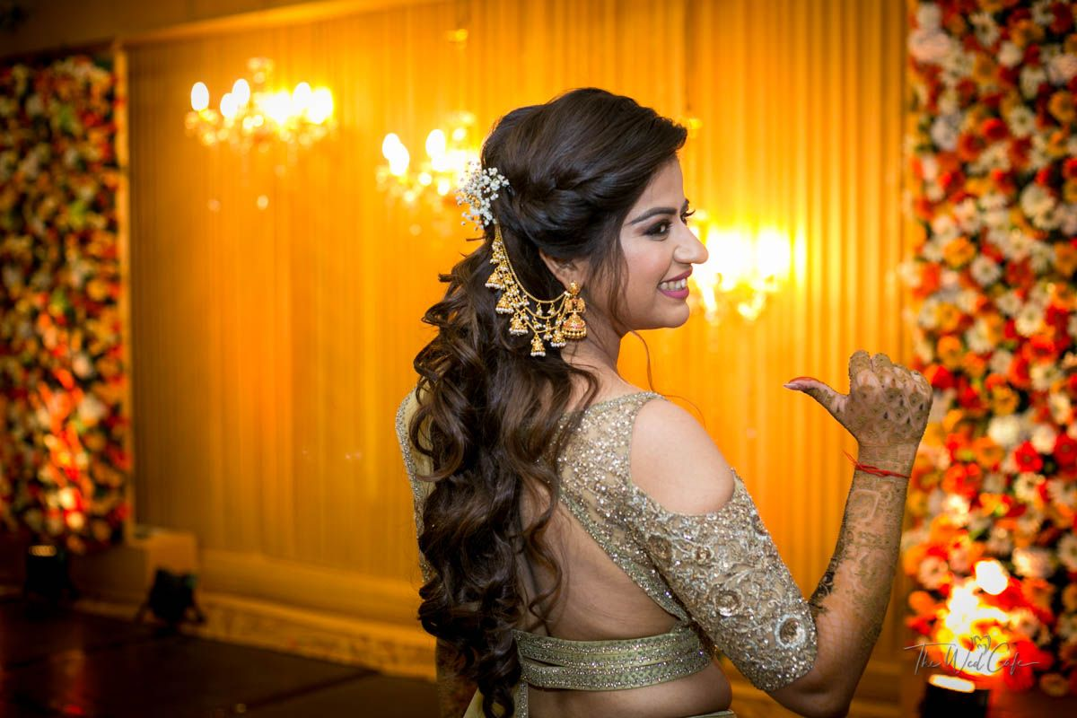indian hairstyles for weddings with bahubali jhumkas