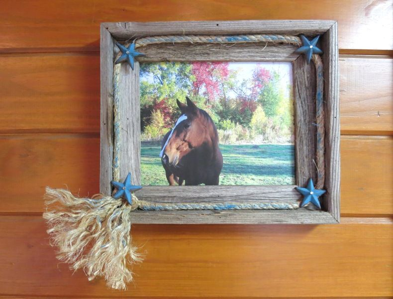 Dress up a barn wood frame with painted star nails and rope