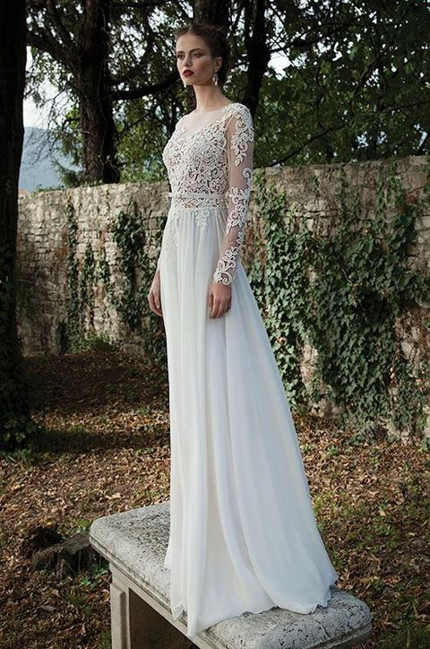 Picture Of illusion V neckline lace wedding dress with a flowy skirt