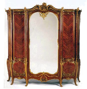 A Stunning Late 19th century Gilt Bronze Mounted Floral Marquetry Armoire. By Joseph Zwiener.