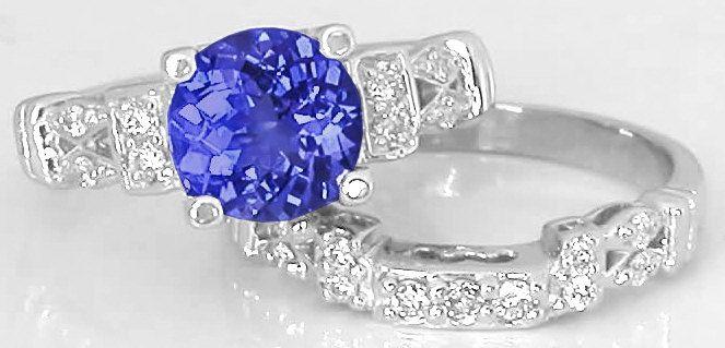 Round Tanzanite Engagement Ring With Three Matching Wedding Band Options