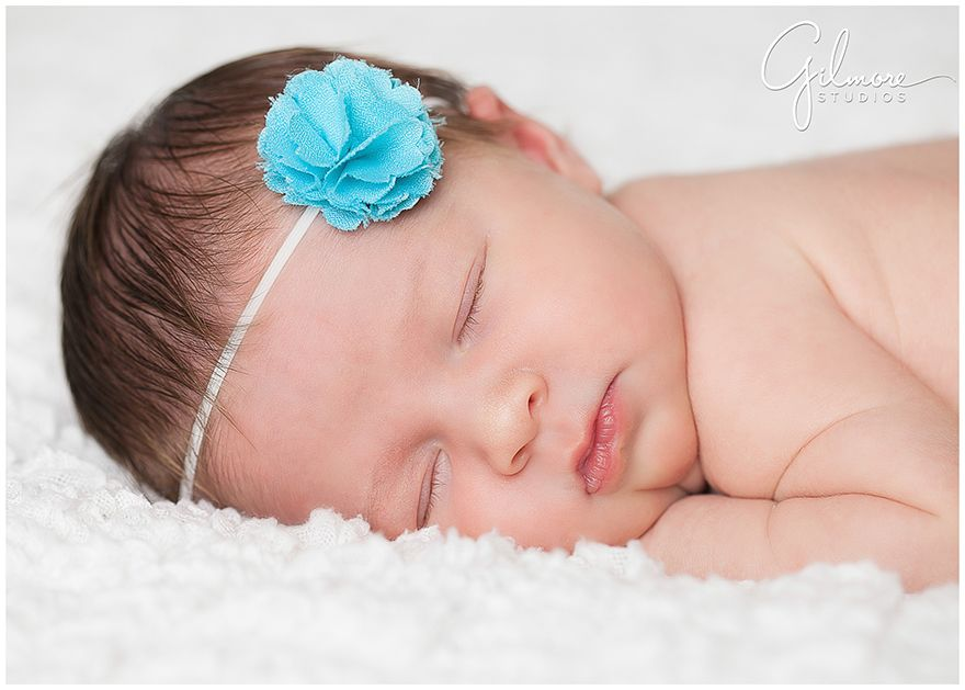 Newborn baby girl session at our studio orange county baby photographer newborn weddings