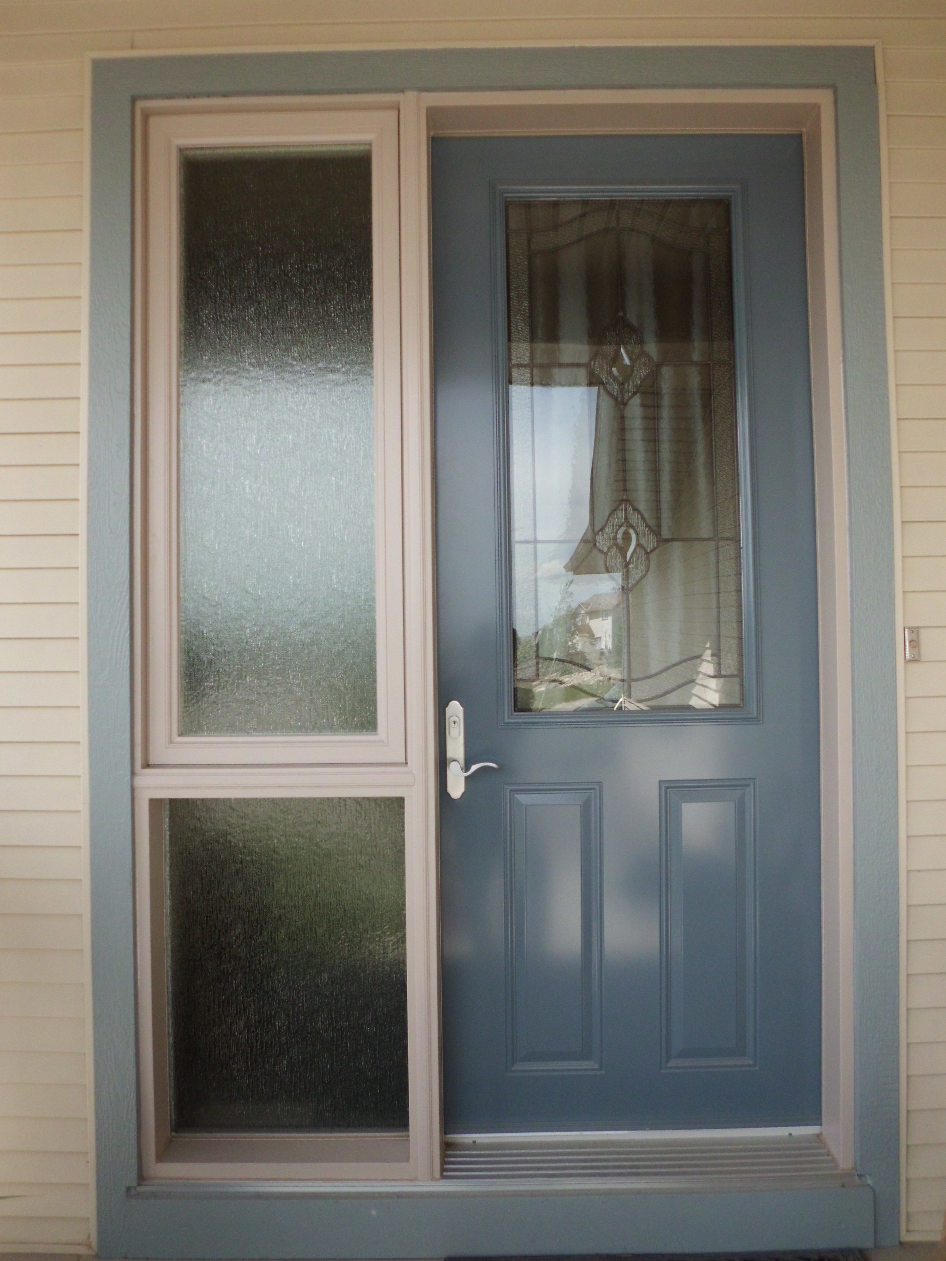 Porto glass insert in door by medival wedgewood blue coloured single entry door with sidelite Exterior doors installation calgary