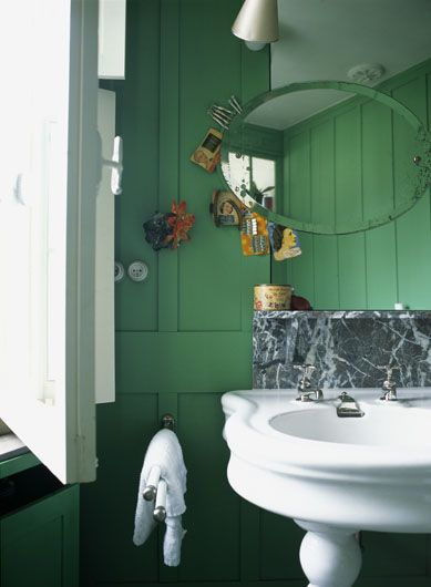 like the green wood cabinet and walls  downstairs