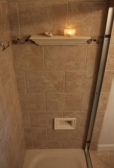 "Bathroom Tiles Height great idea! an integrated shower foot rest. located at 18"" height"