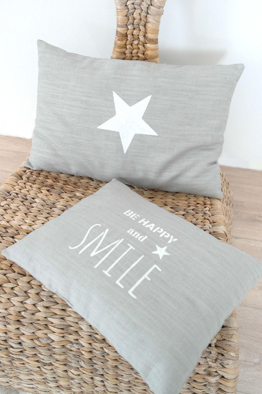Coussin en lin de couleur gris clair avec étoile blanche, pour un ...