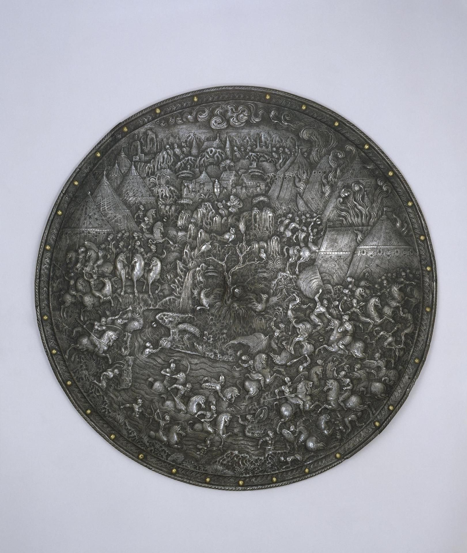 Pageant Shield. Place of creation: Italy. Date: 1560-1570. School: Milan. Material: steel. Technique: forged and chased.