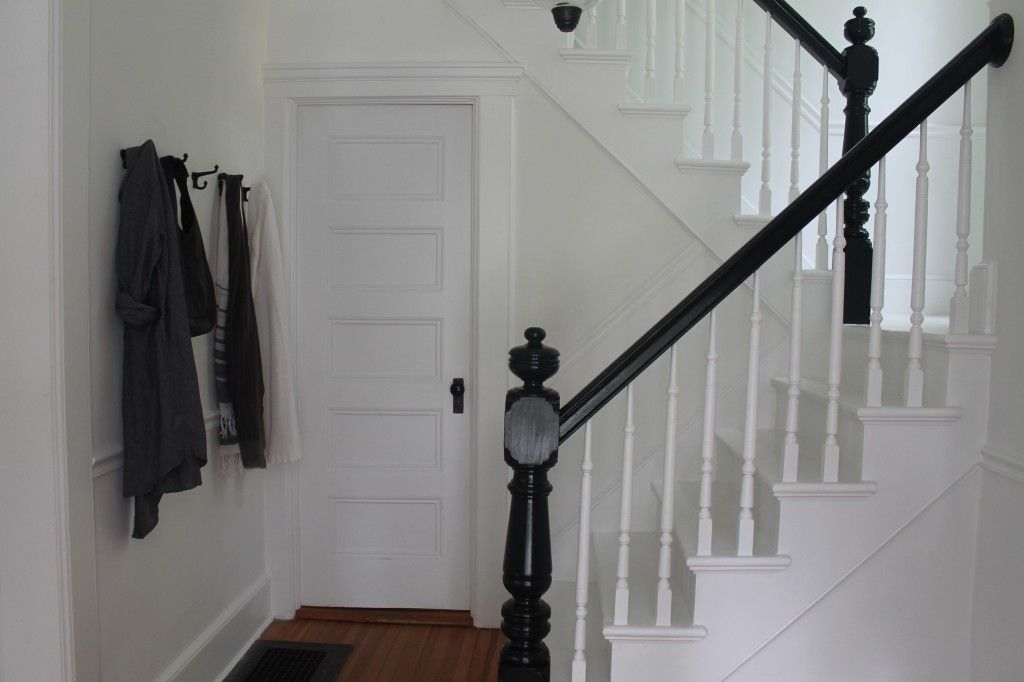 White Entryway With Stairway With Black Banister Black Banister Black Stair Railing Staircase Design