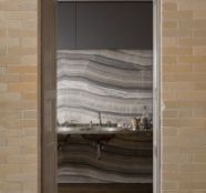 love the use of slab material on wall!