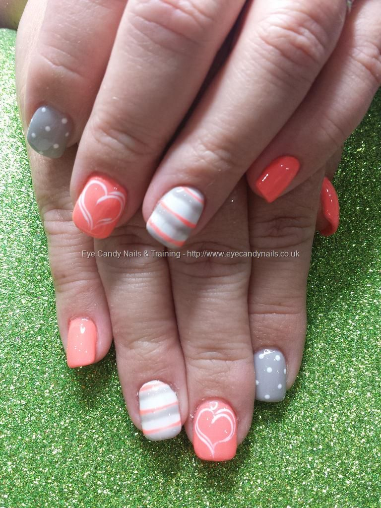 peach white and grey gel polish with hearts spots and stripe nail