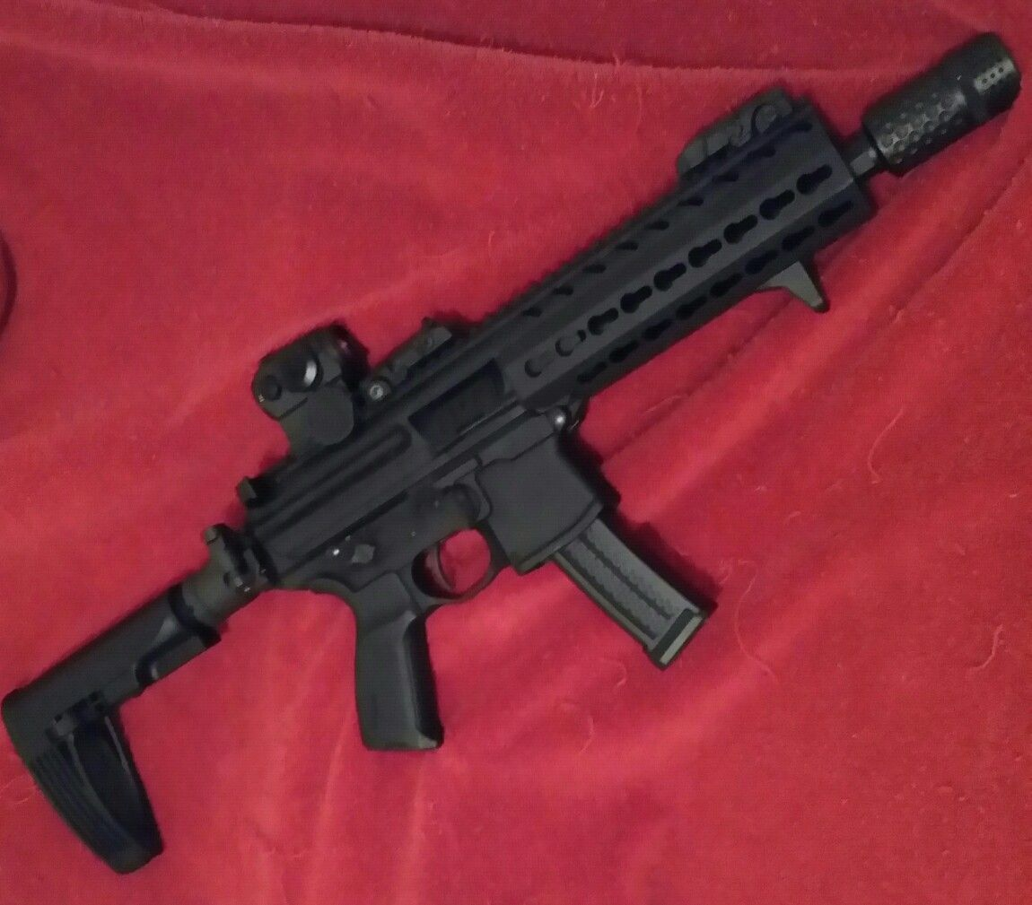 Sig mpx with the new Gearhead Works brace, Spikes Tactical Barking
