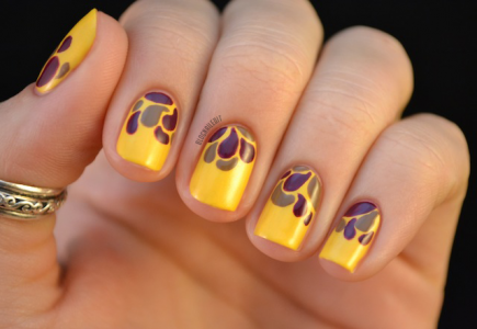 Forget leaving the brights behind in August. Take a note from Nailed It's fall nail art and create a colorful design with gold, purple, and gray hues. #nails #fall