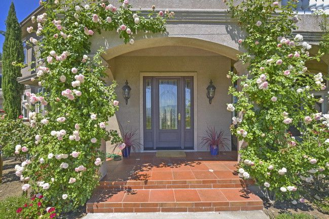 Roses framing front door on Napa Valley Estate. Additional photos and information at http://naparealestatematch.com/listing/1819-foothill-blvd-calistoga-ca/