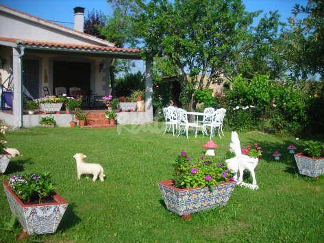 Decoraci n de jardines de casas de campo para m s for Creacion de jardines