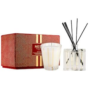 c39a2e121332e Shop NEST s Holiday Candle and Diffuser Set at Sephora. This set including  a scented candle and reed diffuser with a sparkling holiday scent.