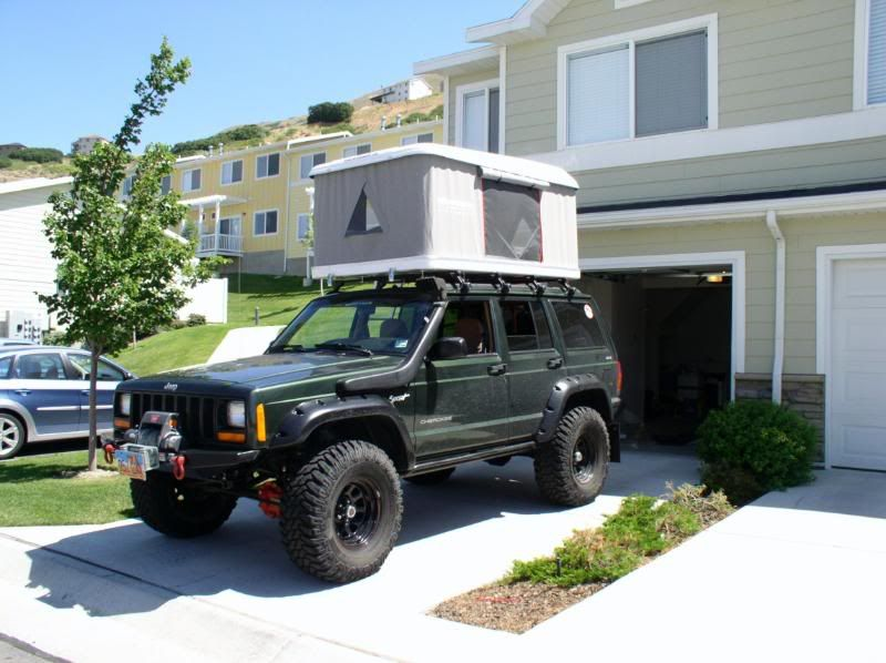 Jeep Cherokee Xj Tent Have A Safari Snorkle And Had To Trim Fender Flare Material To Get Jeep Cherokee Xj