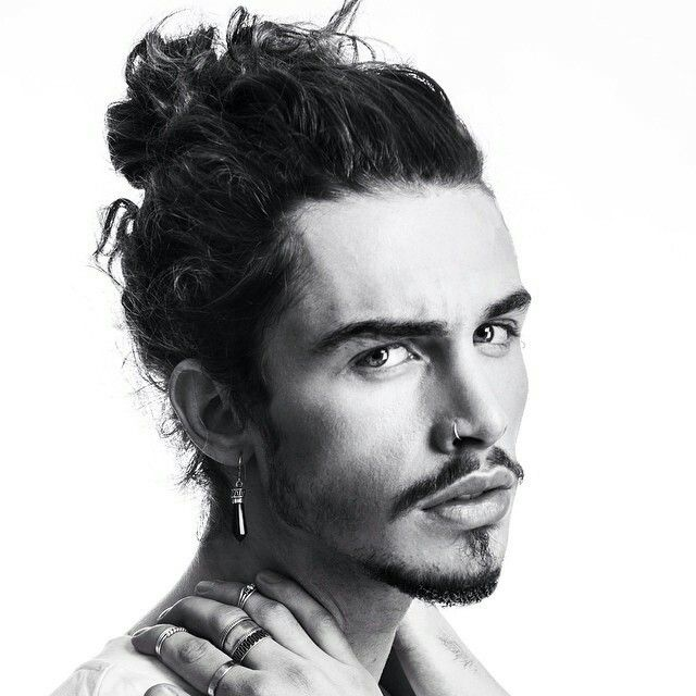 Man With His Hair Tied Up Man Bun Hairstyles Long Hair Styles Men Goatee Styles