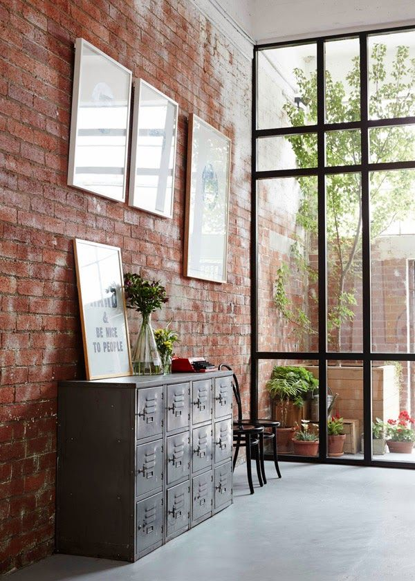 Exposed brick wall inspo Industrial sideboard Black-framed