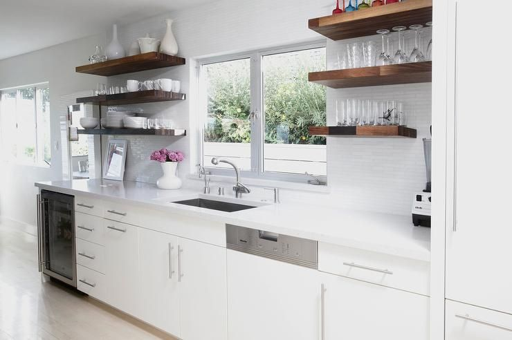 Chic Kitchen Features White Flat Front Cabinets Paired With White Quartz Counter Wood Shelves Kitchen Floating Shelves Kitchen Wooden Shelves Kitchen