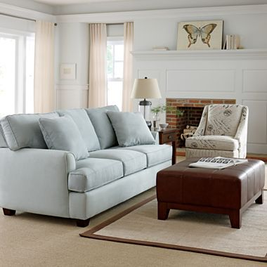 White Walls, Light Blue Sofa, Peachy Drapes