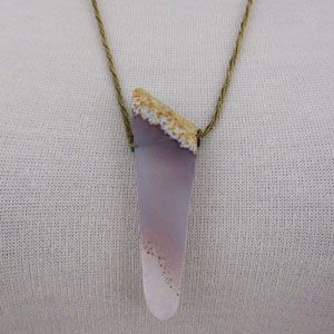 smooth amethyst crystal, as if it were worn by the sea