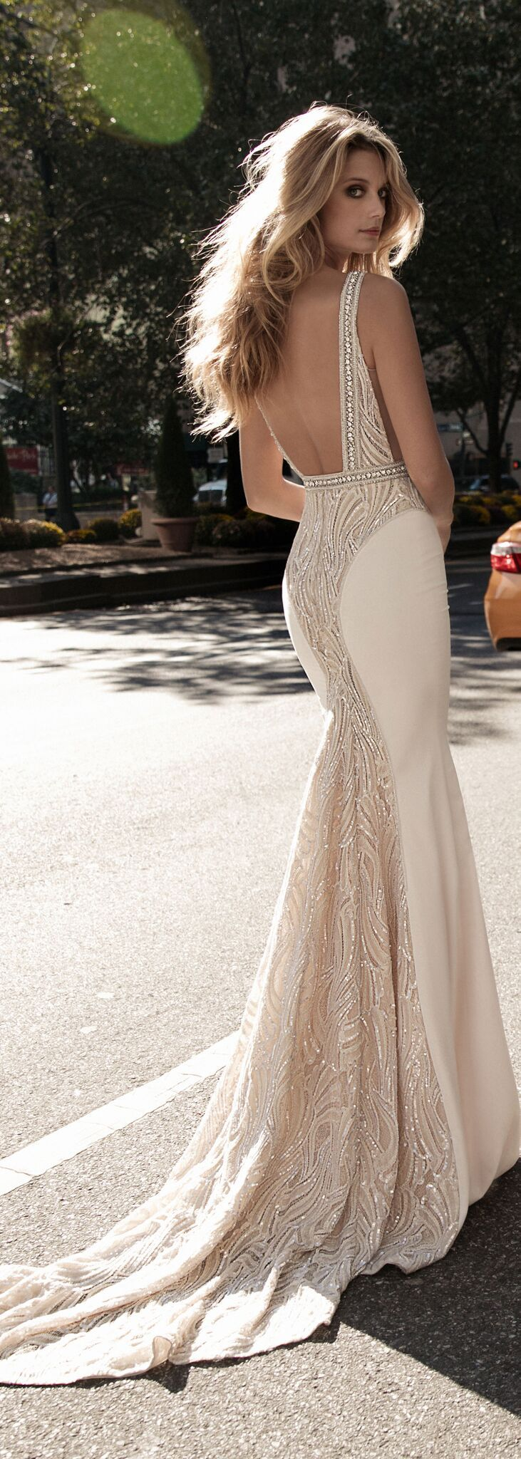 Beautiful texture at the back of these bertabridal wedding dress