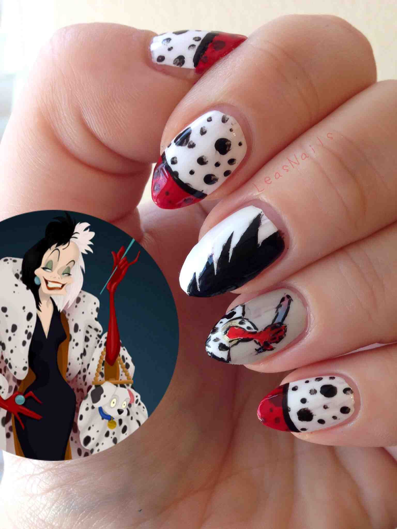 Cruella Deville inspired nails. I like the dalmatian patterned ones ...