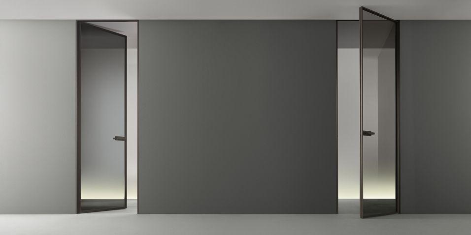 The Flush Door Zen Brown Aluminum Structure And Transparent Gray