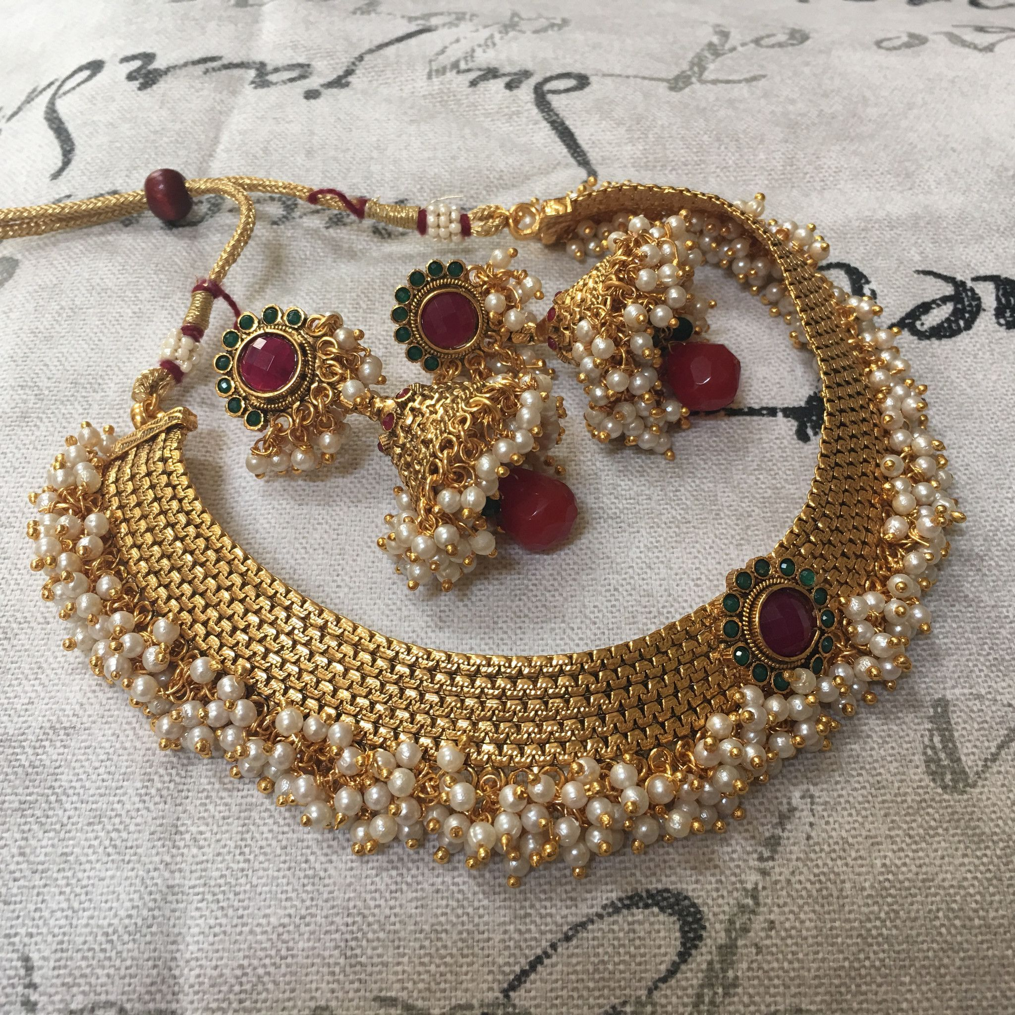 Golden fit necklace with moti and colored center flower making