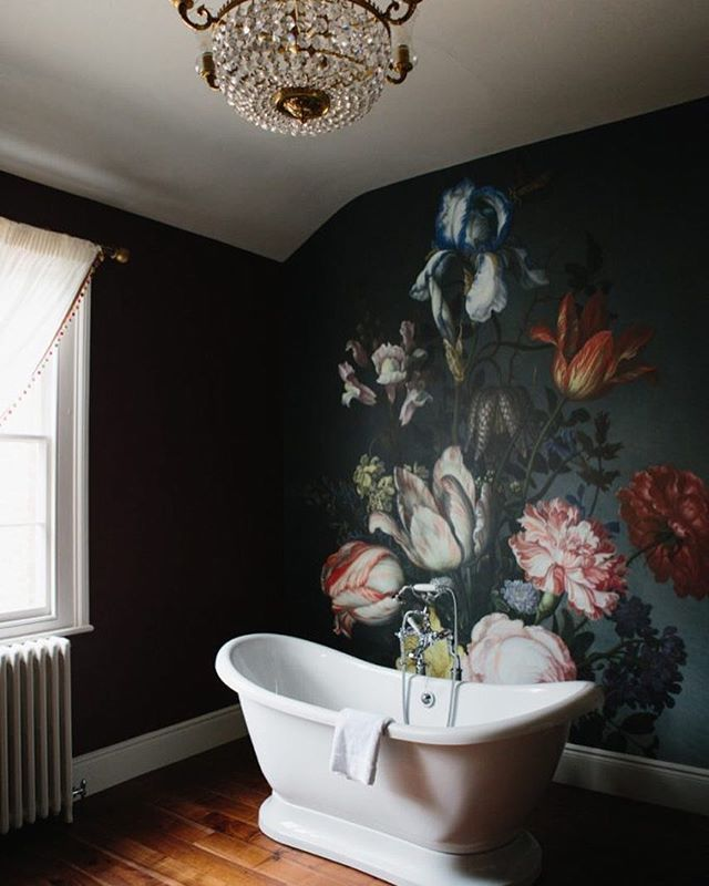 A Home Tour Of Garthmyl Hall Bathroom With Dark Wood Floors White Bathtub Hanging Crystal Chandelier And Large Painted Floral Mural