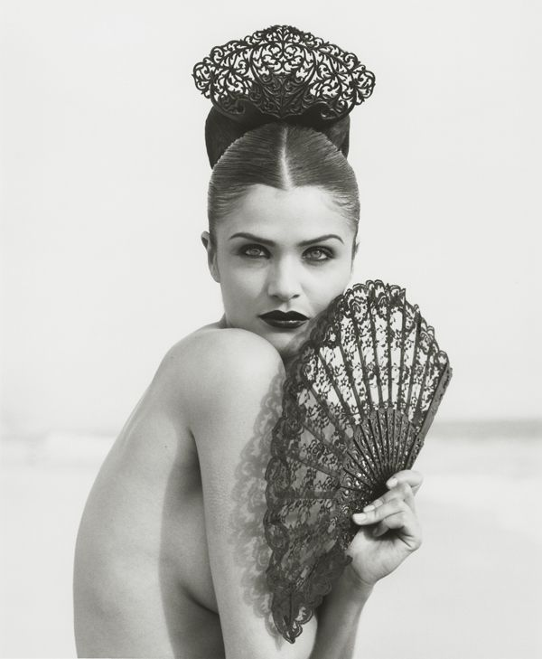 Helena Christensen photographed by Herb Ritts in Malibu, 1996.