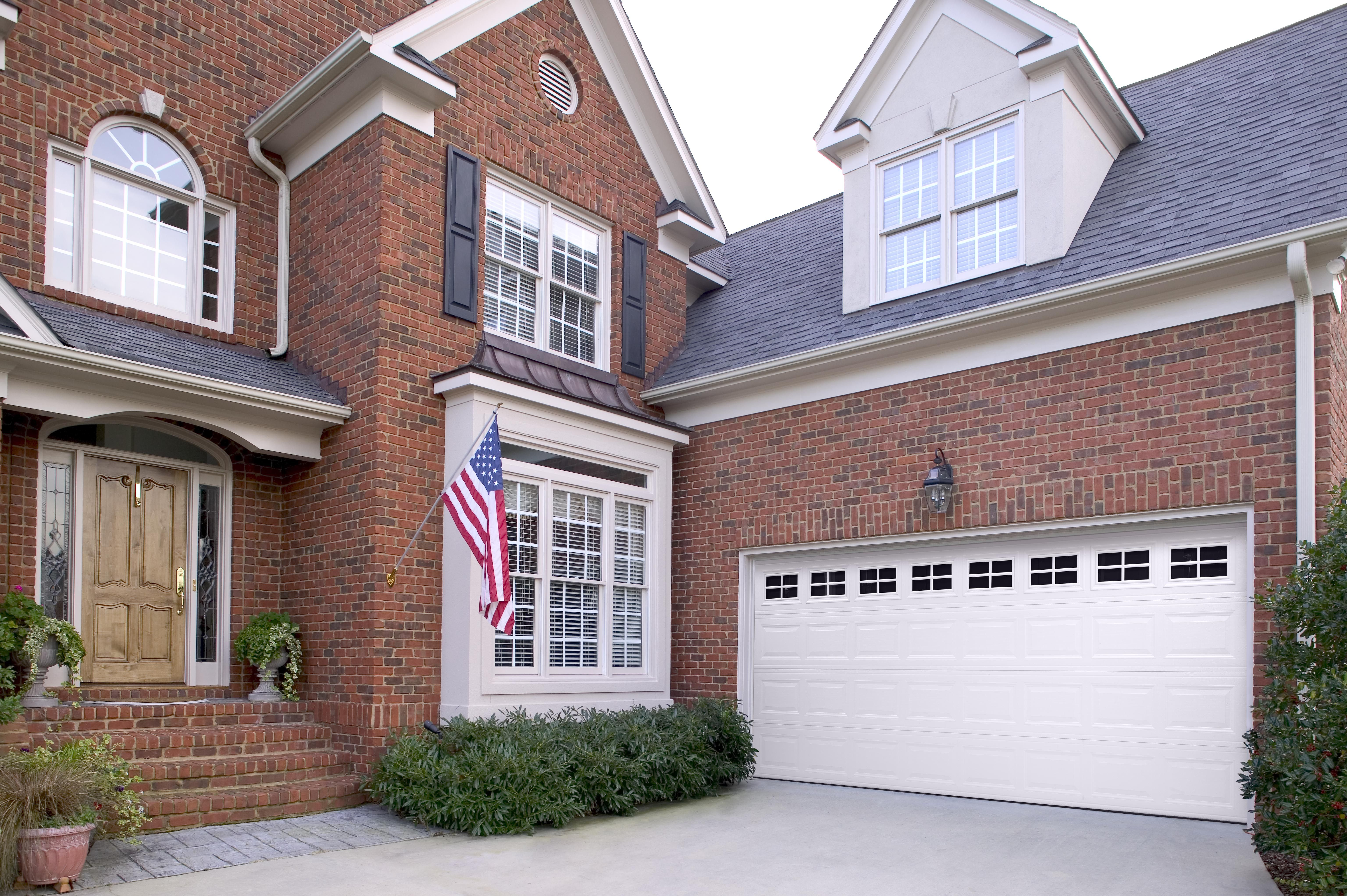 Amarr Short Panel Garage Door In True White With Stockton Windows.  Available In Olympus,