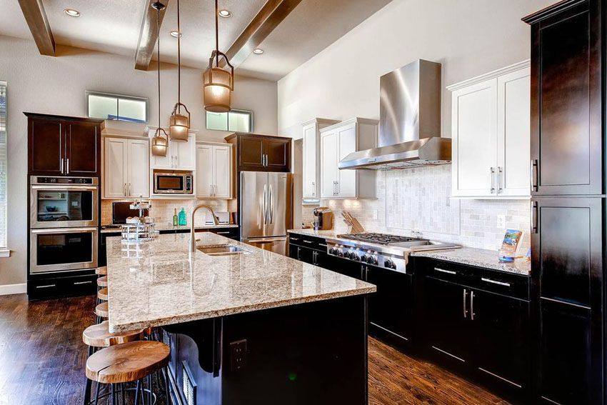 Incroyable Transitional Kitchen Design With African Rainbow Granite Counters, Dark  Shaker Cabinets And Mini Pendant Lights