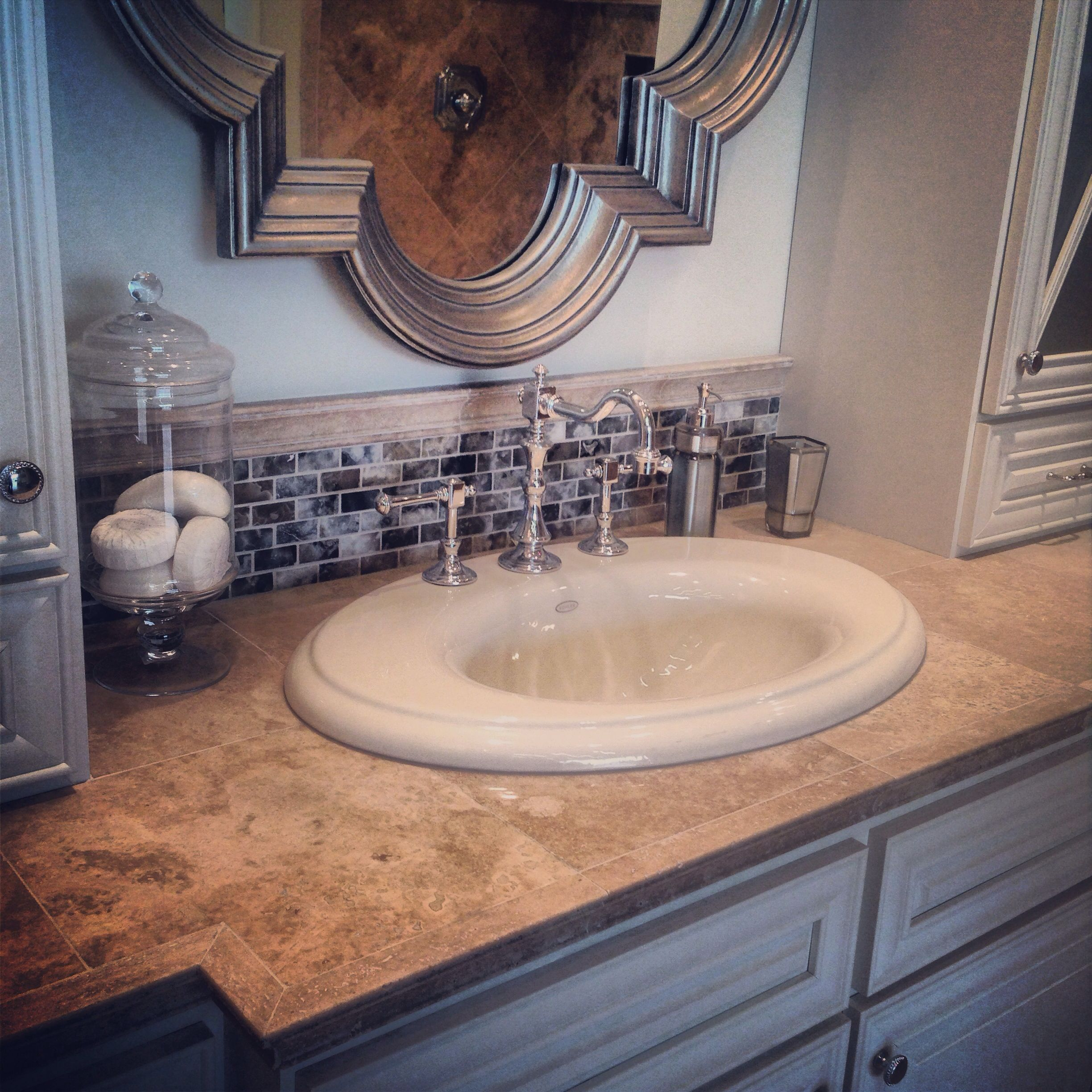 Best Countertops For Bathroom: Travertine Tile Countertop For The Vanity. #thetileshop