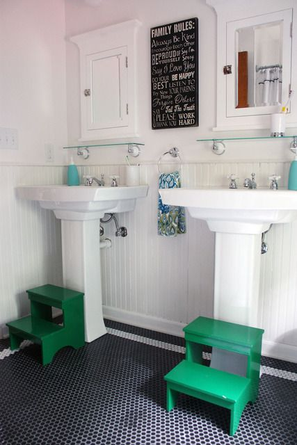 Two Stand Alone Sinks In The Kids Bathroom With Step Stools In