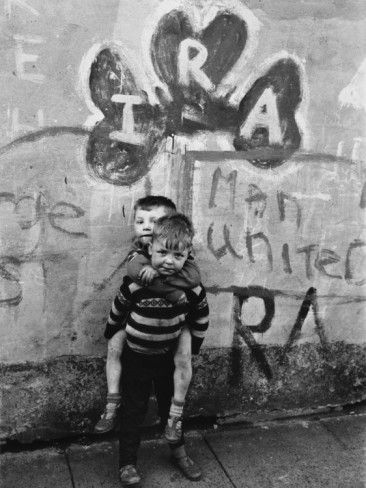 'Two Dirty Boys Stand in Front of Ira Graffiti in Northern Ireland' Photographic Print - | AllPosters.com