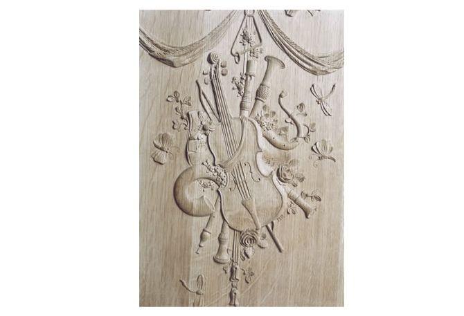 Luikse sculptuur snijwerk ornamenten houtsnijwerk boiserie lambriseringen wandbetimmering lambrisering panelen leefkamer meubelen Houtsnijder ornamentist Patrick Damiaens
