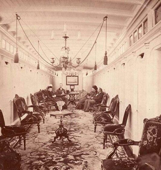 View inside the passenger lounge on the steamboat 'City of Wiinipeg' on the Red River circa 1881, Manitoba