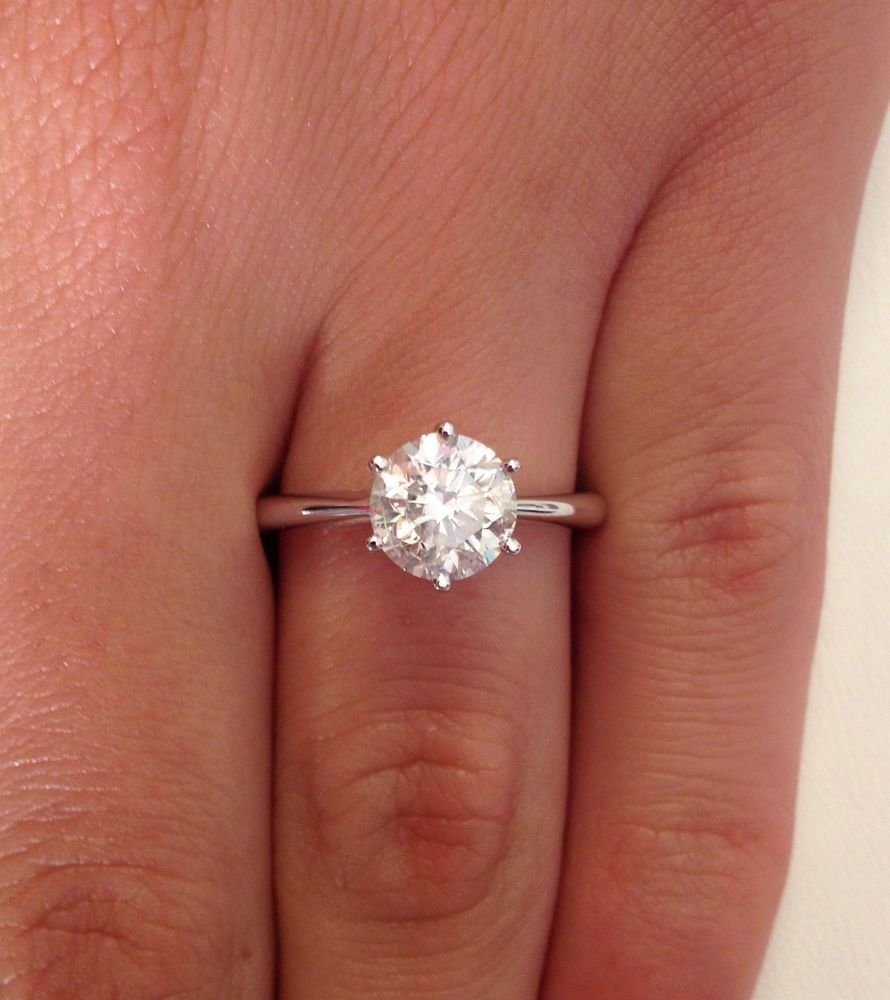 1 CT 6 Prong Round Cut diamond engagement ring with a Slight