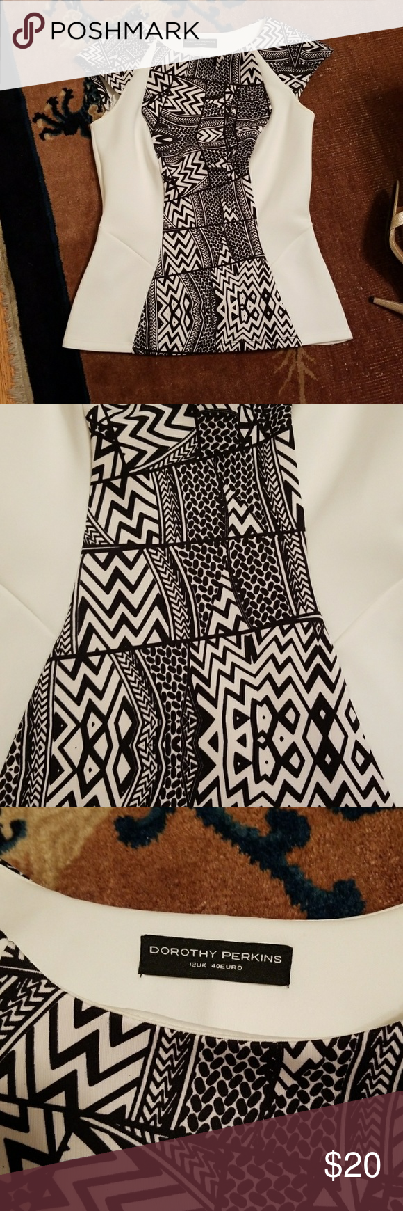Dorothy Perkins Black and White flared top Gorgeous cap sleeve black and white printed top. Not quite a peplum, but is fitted through bodice and has slight flare toward bottom. It's a European size 12, but it for me perfectly when I was a size 6/8 US. Fabric is soft and stretchy. Hits around top of hip. Worn once. Like New condition. Dorothy Perkins Tops