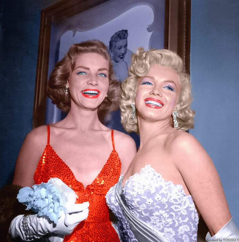Lauren Bacall and Marilyn Monroe attend the premiere of 'How To Marry A Millionaire' on November 4, 1953