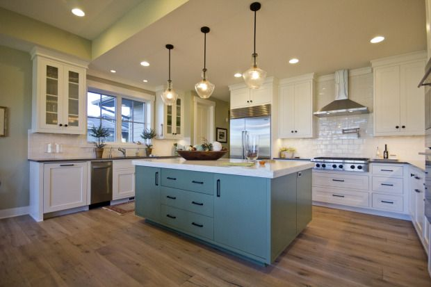 Awesome kitchen with green turquoise island by Greg Welch Construction