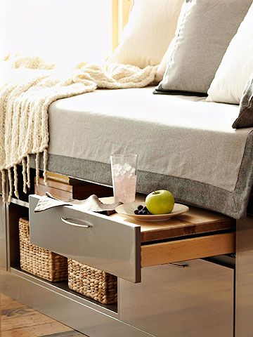 I NEED to do this someday...  small bedroom | Kitchen-Inspired Bedside Storage: Find unexpected yet convenient storage space under your mattress. Join kitchen cabinet components to fashion a platform bed base. Fill open shelves with baskets of reading material and deep drawers with folded clothing. Top a shallow drawer with a slab of wood or countertop to serve as a pull-out nightstand.
