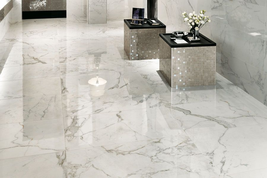 Marvel Calacatta Extra Calacatta Marble Beautifully Reinterpreted In Large Format Porcelain Tile Http Granite Flooring Porcelain Tile Bathroom Tile Floor