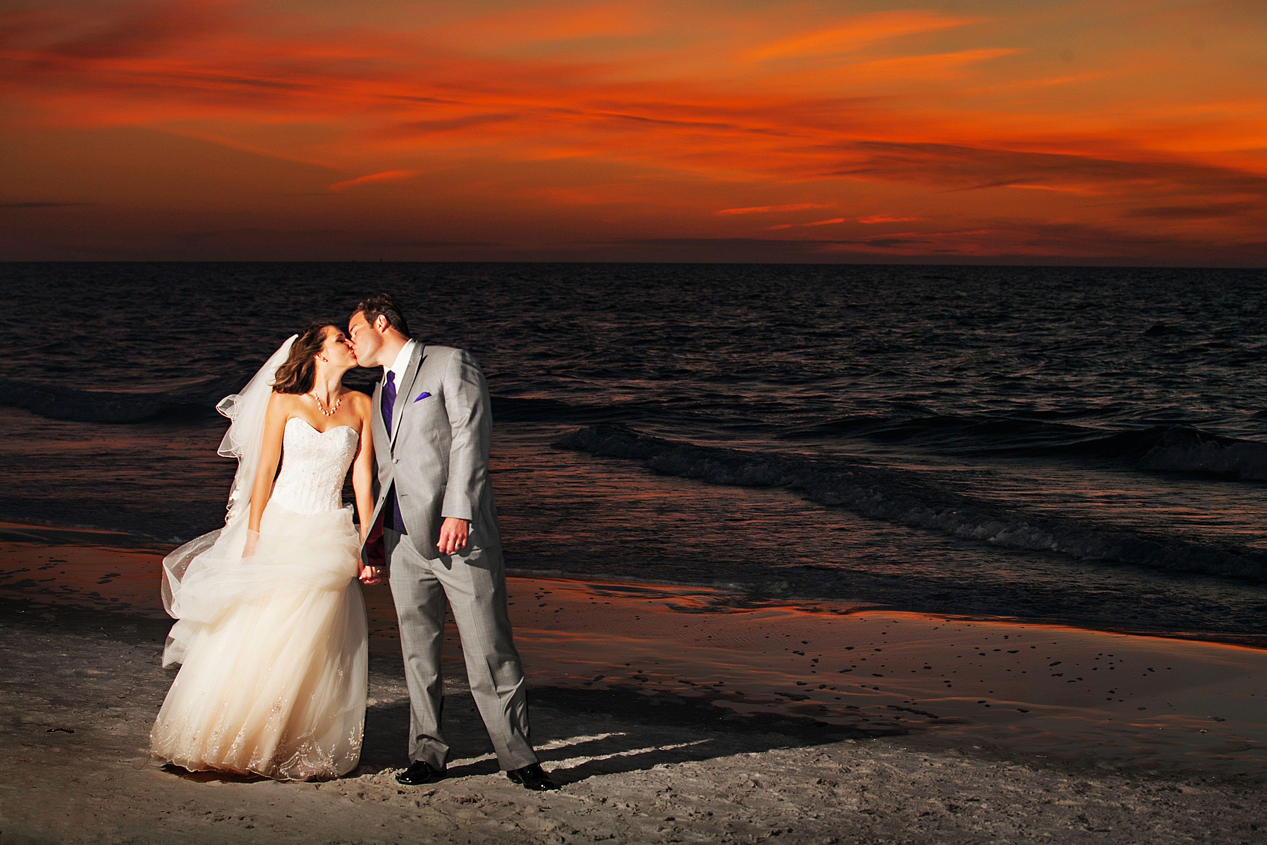 A purple beach wedding at loews don cesar resort in st