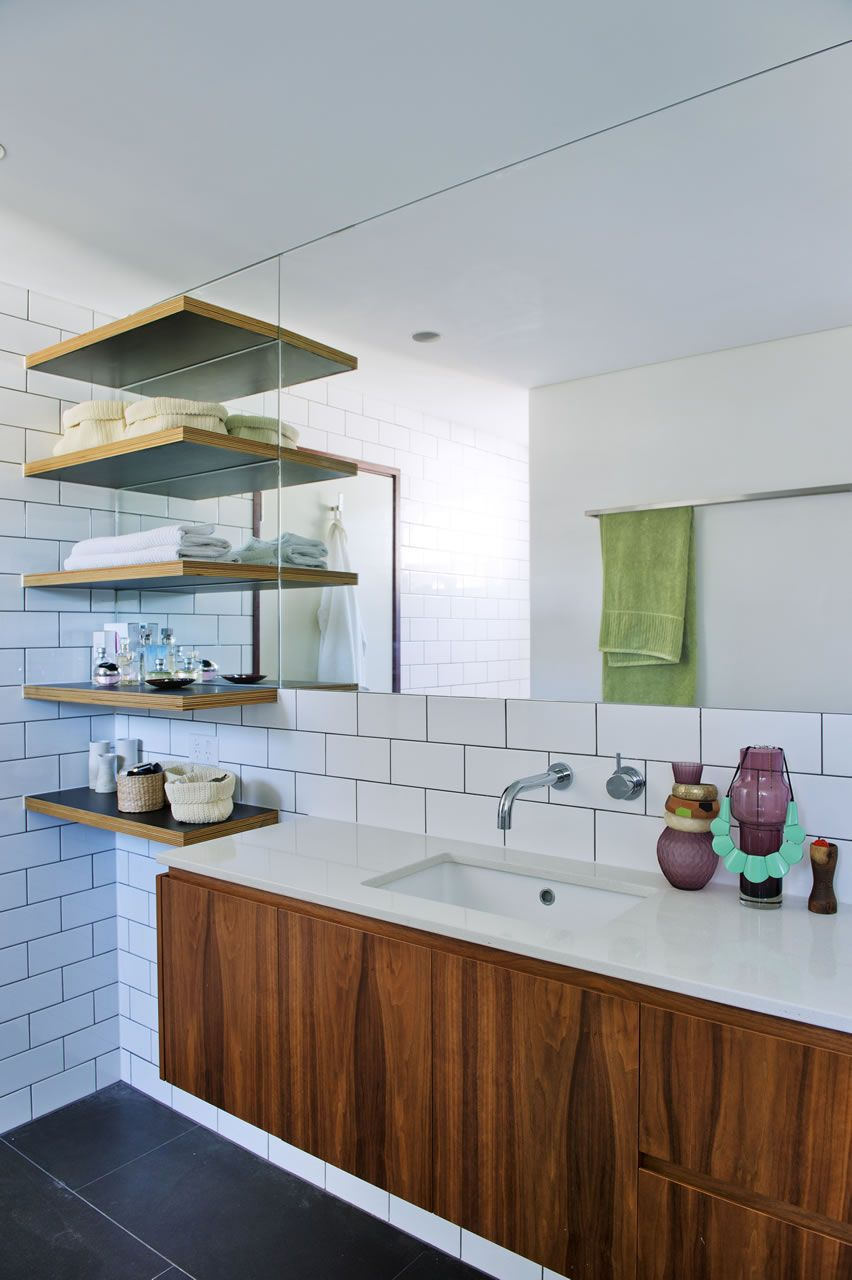 charcoal floors + white subway tiles + dark grout + floating wood