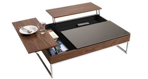 It's a coffee table! It's a computer desk! It's a feeding trough! I appreciate versatile and multifunctional design, and this little number (I believe it's from Bo Concept) is right up my alley.