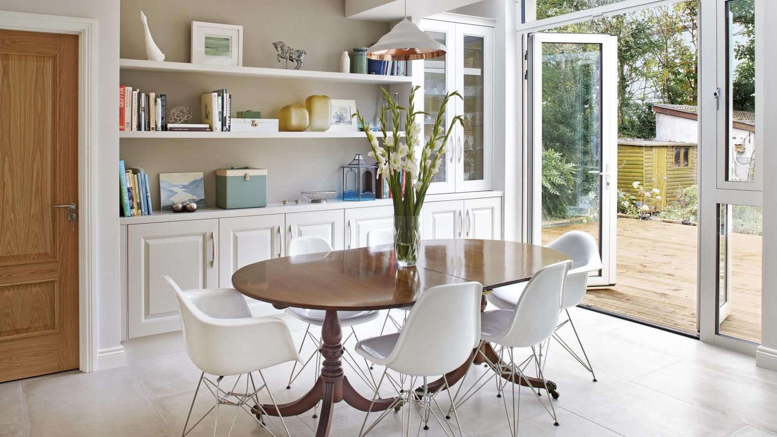 Dining room with traditional table and modern chairs