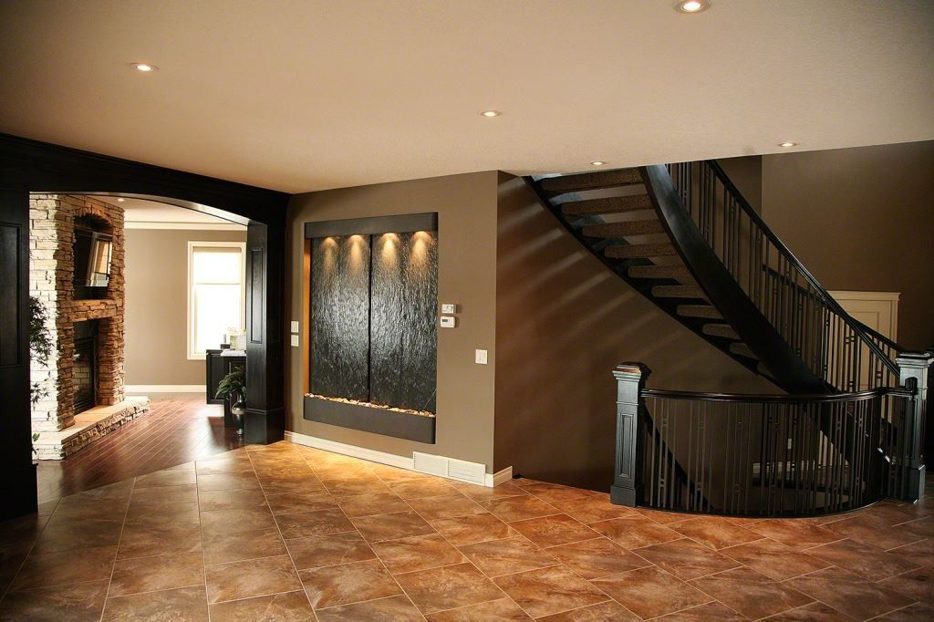 Indoor Water Fountain with spiral stair case in entry way. Very ...